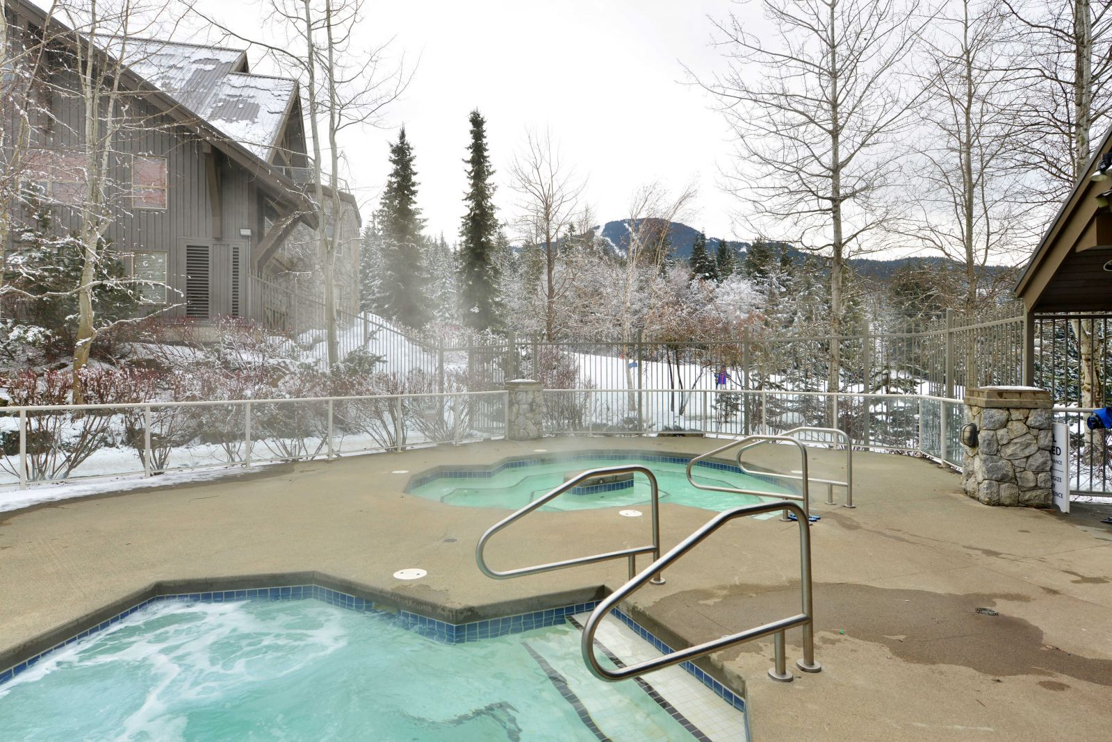 Aspens Lodge hot tub with views of Blackcomb