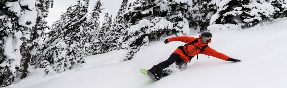A Snowboarder Enjoying Fresh Lines